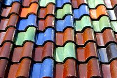 Roof tiles. Old roof tiles on house Stock Photography