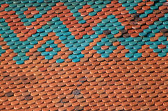 Roof tiles. Newly reconstructed tiles on the roof of a 19. century church  in Vienna, Austria Royalty Free Stock Photo