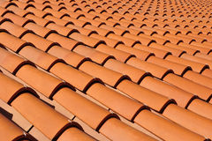 Roof Tiles. Orange roof tiles made from a ceramic material Stock Photo