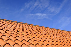 Roof Tiles. Orange roof tiles made from a ceramic material and the sky above Royalty Free Stock Image