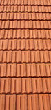 Roof Tiles. A vertical background of red roof tiles Royalty Free Stock Photos