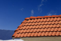 Roof tiles against ski slope Royalty Free Stock Photography