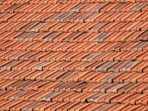 Roof tiles background. Red and orange ceramic tiles on a roof. Mediterranean architecture Royalty Free Stock Photos
