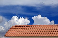 Roof tiles and blue sky Stock Image