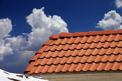 Roof tiles and blue sky Stock Photos