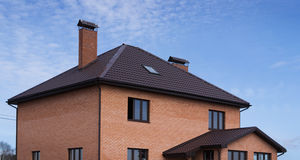 Roof tiles in a brick house Royalty Free Stock Photo