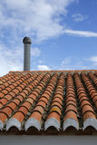 Roof tiles with chimney Royalty Free Stock Photo