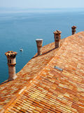 Roof tiles and chimneys on Duino castle Stock Image