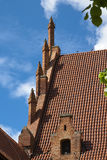 Roof tiles and decorations in Malbork Royalty Free Stock Photography