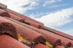 Roof tiles. Details of red roof tiles against blue sky Royalty Free Stock Photography