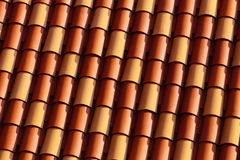 Roof tiles on the European house. Red and yellow Roof tiles on the European house Royalty Free Stock Photos