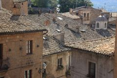 Roof tiles from the houses in the village Orvieto in Italy. A view over the roofs some with dormer window in one of the streets in the residential area in the stock photos