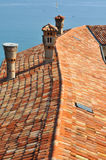 Roof tiles and mediterranean sea Stock Images