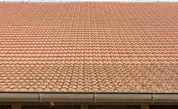 Roof tiles on an old barn as a background royalty free stock photos