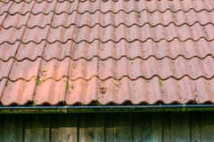 Roof tiles on old house closeups. Close-up of roof boilers on old house, pictures on time to renovate, companies selling home goods. Macro photo, color neutral stock photo
