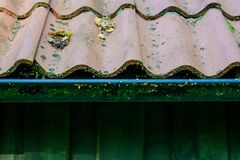 Roof tiles on old house closeups. Close-up of roof boilers on old house, pictures on time to renovate, companies selling home goods. Macro photo, color neutral royalty free stock image