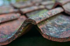 Roof tiles on old house closeups. Close-up of roof boilers on old house, pictures on time to renovate, companies selling home goods. Macro photo, color neutral stock image