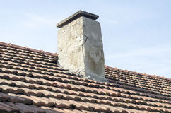 Roof tiles over bly sky Stock Images