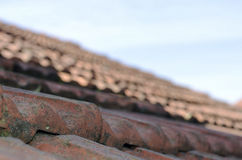 Roof tiles over bly sky Royalty Free Stock Photos