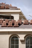Roof tiles before picture. Roof tiles being installed on a new home Royalty Free Stock Photography