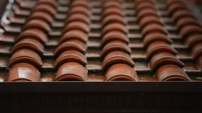 Roof in a rainy day. Roof tiles in a rainy day stock video footage