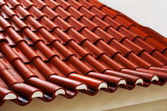 Roof tiles - red tiles or shingles on house   as background and Stock Photos