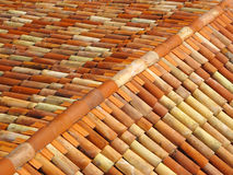 Roof tiles with ridge tiles on top. Made from fired clay. Texture or background concept Royalty Free Stock Photography