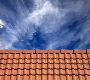 Roof tiles and sky with clouds Royalty Free Stock Images