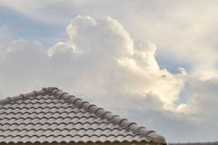 Roof tiles and sky sunlight Stock Images