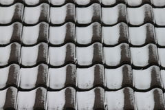 Roof tiles with snow powder Stock Images