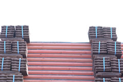 Roof tiles stacked in piles on wooden battens Stock Images