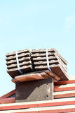 Roof tiles stacked in piles on wooden battens Royalty Free Stock Photo