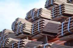 Roof tiles stacked in piles on wooden battens Stock Image