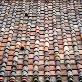 Roof tiles texture. Clay shingle roof. Roof tiles texture. Detail of an old, weathered clay shingle roof. Water damage, lichen Royalty Free Stock Photo