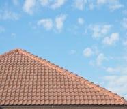 Roof tiles under blue sky Stock Photos