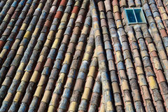 Roof tiles and window Stock Image