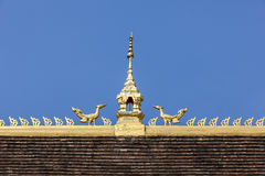 Roof top on blue sky of Laos temple Stock Photography