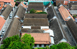Roof top of Buddhist temple in Bangkok, Thailand. Aerial view of brick buildings in Bangkok, Thailand. Bangkok multi-faceted sights, attractions and city life Stock Photo
