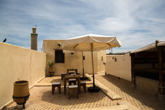 A roof top cafe on the terrace of a museum in Fes, Morocco. A cafe on the terrace of the Nejjarine Museum of Wood Arts & Crafts in the Fes Medina, Morocco. In Stock Photos