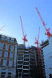 Roof Top Cranes. High rise construction site with roof top cranes Stock Image