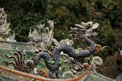 Roof Top Figurine. A Dragon decorates a Roof Top of a Chinese Buddhist Temple in Da Nang, Vietnam stock photo