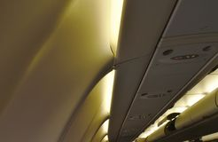 Roof top and lamp in cabin on commercial plane. Roof top and lamp in passenger cabin on commercial plane stock photos