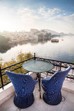 Roof top restaurant in Udaipur. Roof top restaurant with beautiful view to Lake Pichola in the morning in Udaipur, Rajasthan, India Stock Photography