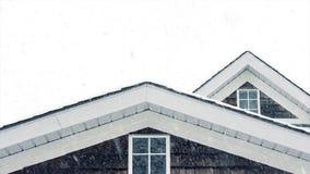 Roof top in snowfall stock video footage