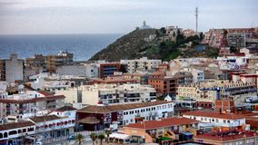 Roof top view of a Spanish town with the sea in the background stock photo
