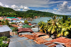 Roof tops. Beautiful view of some rusty tin roof tops overlooking Lake Taal, Philippines Stock Photo