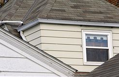 Roof Tops. And angles with a window, siding and shingles Royalty Free Stock Images