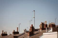 Roof Tops with Chimneys and Ariels. A set of British roof tops with multiple chimneys and television ariels Royalty Free Stock Photo