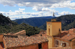 Roof tops and church clock tower above the gorge of Châteaudouble Royalty Free Stock Photography