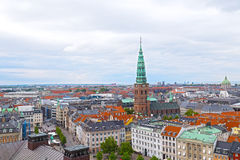 Roof tops of Copenhagen, Denmark. Panorama of colorful roof tops and old churches in Copenhagen, Denmark Royalty Free Stock Photo
